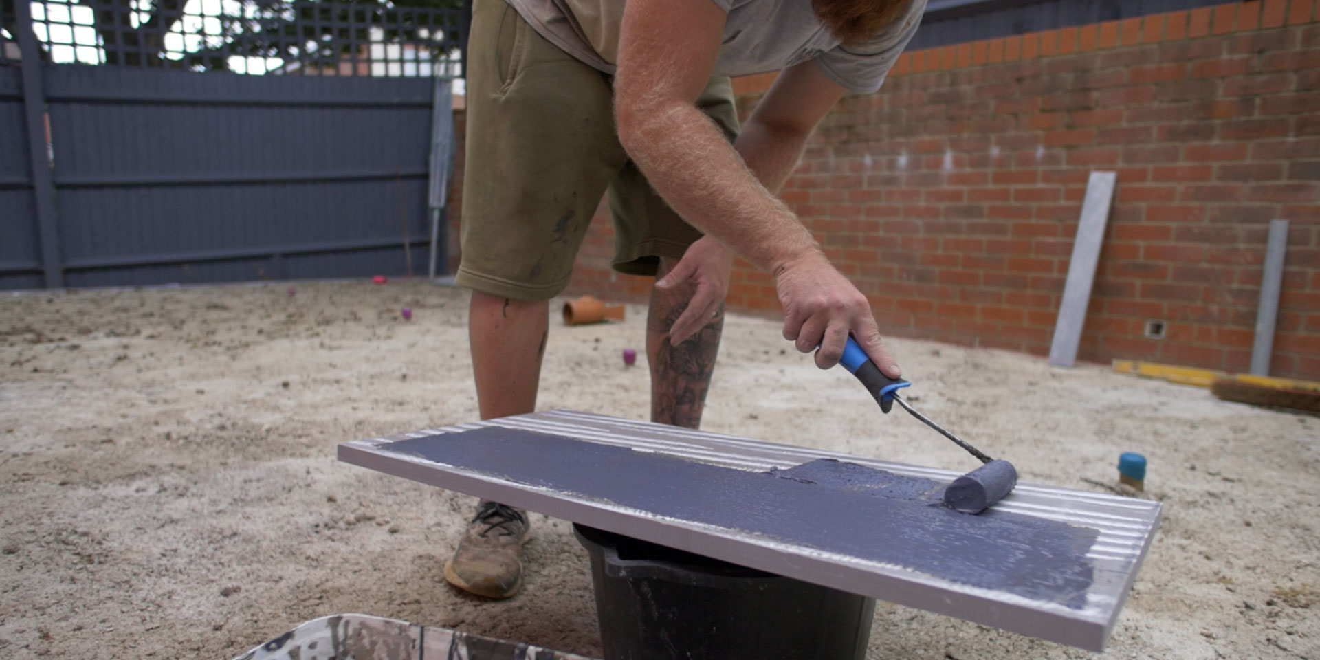 Primer being added to the back of a porcelain tile in Southampton, Hampshire.
